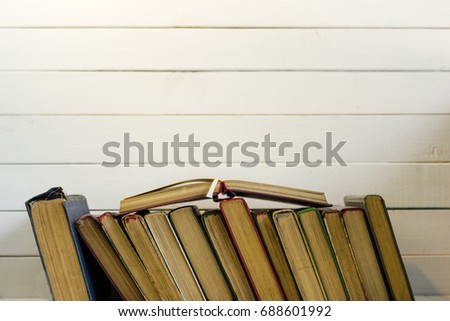 Open book on an white wooden table. Beautiful background. #688601992
