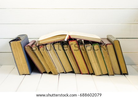 Open book on an white wooden table. Beautiful background. #688602079