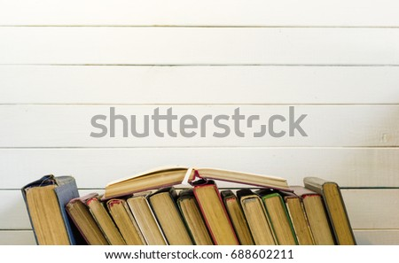 Open book on an white wooden table. Beautiful background. #688602211