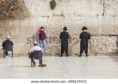 men praying at the wailing wall, jerusalem, israel #688629421