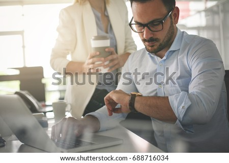 Business people working in office. Business man looking at clock an waiting something. #688716034