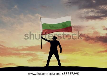 Male silhouette figure waving Bulgaria flag. 3D Rendering #688737295