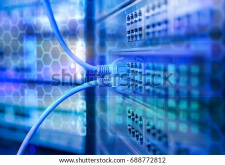 Ethernet network Cables Connected to Internet Switch. Royalty-Free Stock Photo #688772812