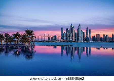 Panorama of Dubai Marina at sunset with a swimming pool in front Royalty-Free Stock Photo #688848562