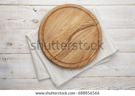 Pizza board and canvas napkin with lace on wooden table. Top view mock up #688856566