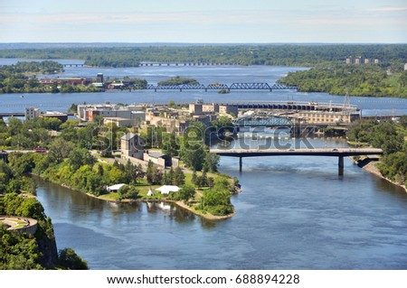 Aerial view of Victoria Island and Chaudière Island on Ottawa River viewed from Ottawa Parliament Peace Tower, Ottawa, Ontario, Canada. #688894228