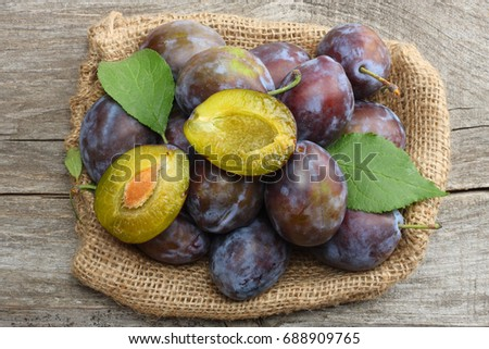 raw plum on old wooden table. top view #688909765
