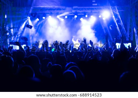 Crowd at concert and blurred stage lights #688914523