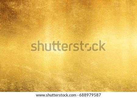 Shiny yellow leaf gold foil texture background #688979587