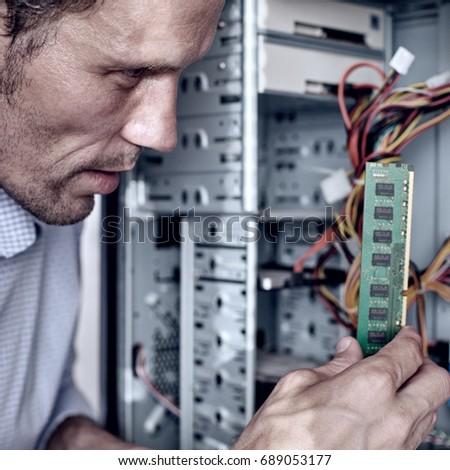 Technician fixing RAM #689053177