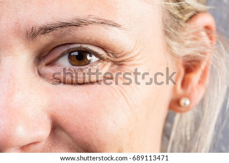 Wrinkled eye of beautiful lady Royalty-Free Stock Photo #689113471