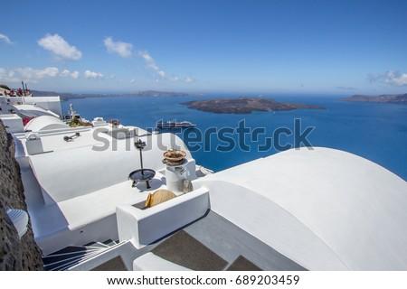 White architecture on Santorini island, Greece. Beautiful landscape with sea view. #689203459