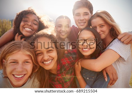 Teenage school friends smiling to camera, close up Royalty-Free Stock Photo #689215504