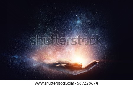 Magic light in palm Royalty-Free Stock Photo #689228674