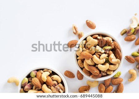mixed nuts in white ceramic bowl  Royalty-Free Stock Photo #689445088