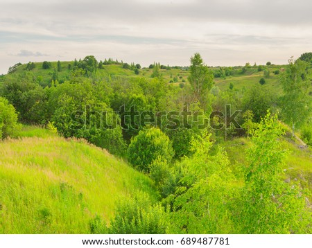 Landscape over an inactive 20-year-old open pit. Ryazan Region, Yambirno District #689487781
