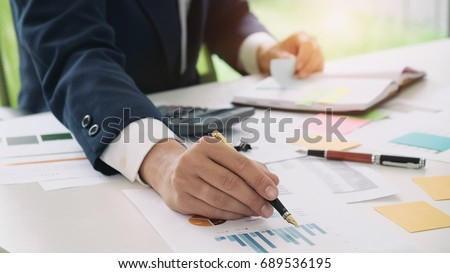 Close up accountant or banker making calculations. Savings, finances and economy concept. #689536195