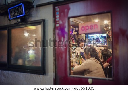 Tokyo, Japan - May 5 2017: The famous Golden Gai with Neon light at night in Shinjuku. Full of restaurants and bars in the neighborhood. #689651803