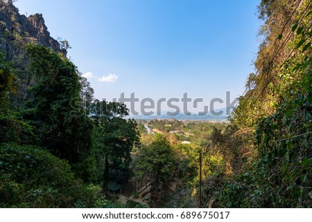 Wide angle picture of amazing view from Tham Chang Cave in the city of Vang Vieng, Laos. Tropical Vegetation.