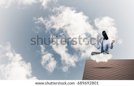 Faceless businessman with camera zoom instead of head sitting in lotus pose #689692801