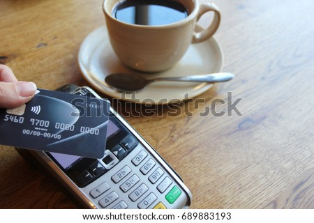 contactless payment card pdq background copy space with hand holding credit card ready to pay at cafe coffee smartcard stock, photo, photograph, picture, image,