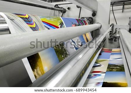 Printing machine fast roll movement during magazine print Royalty-Free Stock Photo #689943454