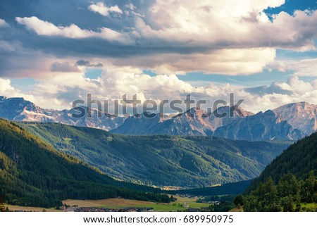 The Santa Maddalena valley with mountain peaks in the background in the Dolomite Mountains, Italy #689950975
