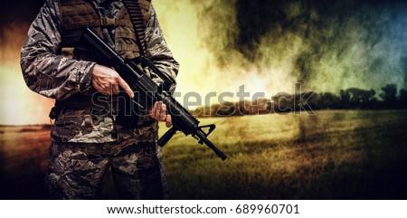 Wheat farm against military carrying a rifle  #689960701
