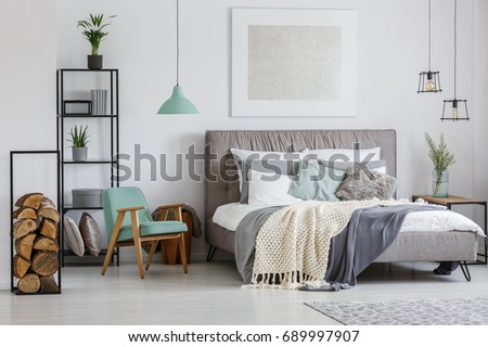 Cozy stylish hotel room with decorative wood pieces in metal frame #689997907