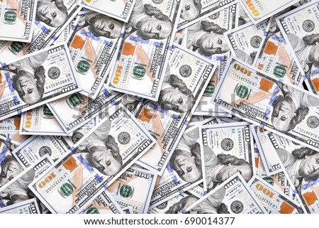 A pile of one hundred US dollars - Banknotes. Cash of hundred dollar bills , dollar background with high resolution Royalty-Free Stock Photo #690014377