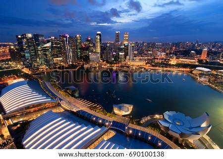 SINGAPORE - APRIL 14, 2017 : Singapore Marina Bay downtown night view from observation deck level 57 of Marina Bay sands hotel  #690100138