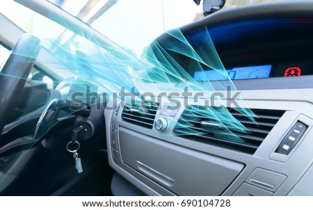 Driver hand tuning air ventilation grille, fresh air is coming out Royalty-Free Stock Photo #690104728