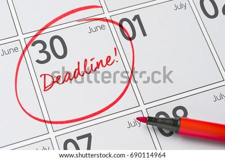 Deadline written on a calendar - June 30 #690114964