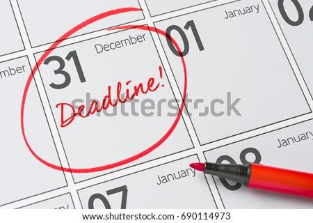 Deadline written on a calendar - December 31 Royalty-Free Stock Photo #690114973
