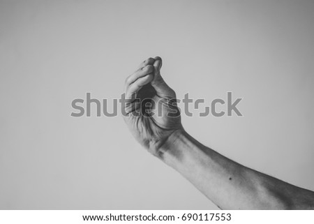 Italian Hand Gestures_What Are You Talking About? Royalty-Free Stock Photo #690117553