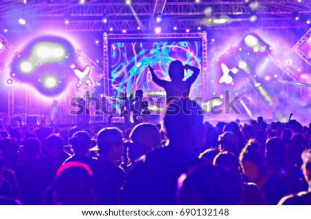 Blurred party people dancing in night club,for background. #690132148