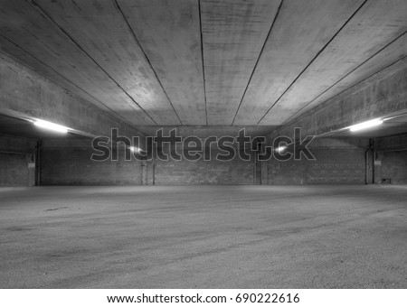 Empty Storehouse Interior for Background. Abandoned Parking Lot. Black and White Look. #690222616