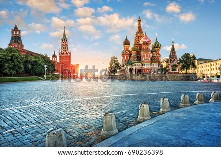 Evening light on Red Square. The St. Basil's Cathedral and the Spassky Tower in the rays of the setting sun.