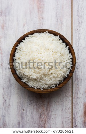 Indian cooked basmati rice in a wooden bowl, over colourful or wooden background, selective focus #690286621