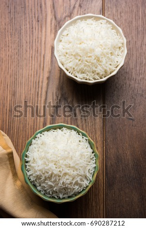 Basmati Rice plain and cooked, served in a ceramic plate or bowl, isolated over colourful or wooden background. selective focus #690287212