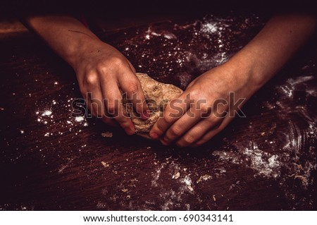 Hands skillfully knead the dough #690343141