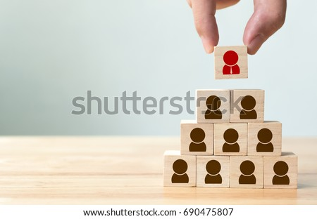 Human resource management and recruitment business concept, Hand putting wood cube block on top pyramid, Copy space Royalty-Free Stock Photo #690475807