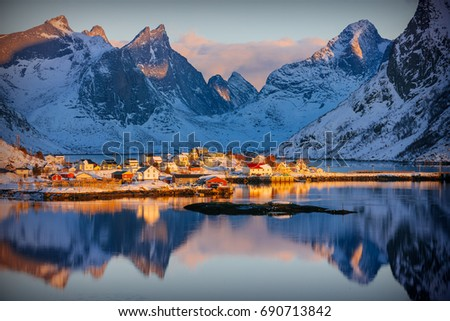 Colorful winter sunrise in the fishing village of Reine, Lofoten archipelago, Norway, above the arctic circle Royalty-Free Stock Photo #690713842