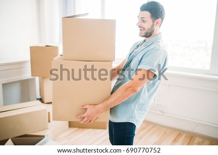 Man holds carton box in hands, housewarming #690770752