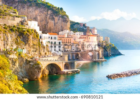 Morning view of Amalfi cityscape on coast line of mediterranean sea, Italy #690810121