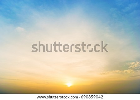 Sky background at sunset,Sky blue and orange light of the sun through the clouds in the sky survive #690859042
