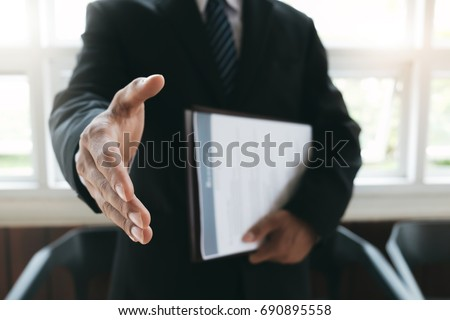 Business find new job, interview the job and hiring. Job applicant holding resume.Open handshake and resume job interview or acceptance. #690895558