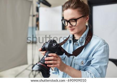Self-employed stock photographer working in studio #690909010