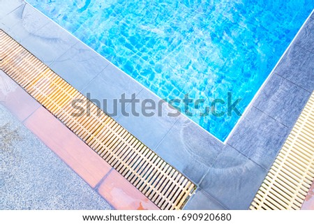 Swimming pool with the blue water. #690920680