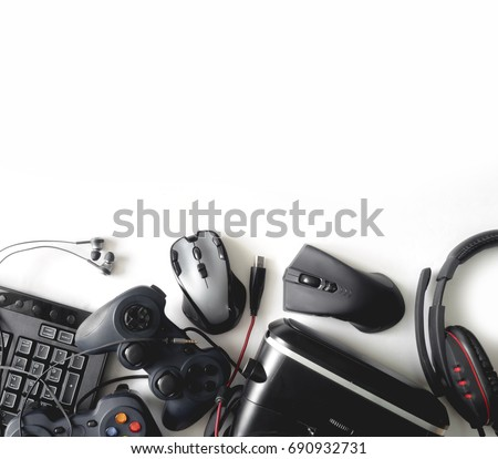 gamer workspace concept, top view a gaming gear, mouse, keyboard, joystick, headset, webcam, VR Headset on white background with copy space.